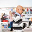Mature man shopping in the supermarket — Stock Photo