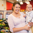 Portrait of Mother and Child in Store — Stock Photo