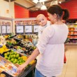 Mother and Baby in Grocery Store — Stock Photo