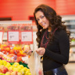 Portrait of a young woman buying fruits — Stock Photo