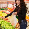 Young Woman Buying Fruit - Lizenzfreies Foto