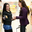 Stock Photo: Happy Grocer Store Women