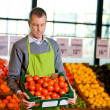 Grocer with Tomatoes — Stock Photo #5714476