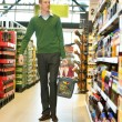 Man walking in grocery store - Stock Photo