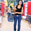 Asian Woman in Grocery Store - Stock Photo
