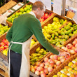 Stock Photo: MWorking in Grocery Store