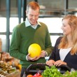 Man and Woman Buying Fruit — Stock Photo #5716579