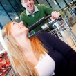 Playful Couple in Supermarket — Stock Photo