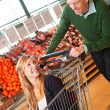 Grocery Store Playful Couple - Stock Photo