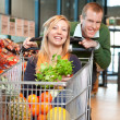 Stock Photo: Portrait of playful couple in shopping store