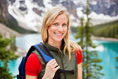 Beautiful female hiker smiling — Stock Photo
