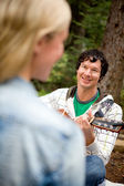 Man Serenading a Woman with Guitar — Stock Photo