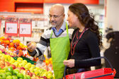 Grocer and Customer — Stock Photo