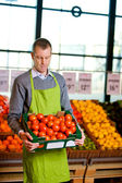 Grocer with Tomatoes — Stock Photo