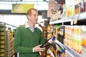 Customer buying bottle of juice — Stock Photo