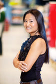 Asian Woman in Grocery Store — Stock Photo