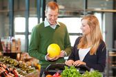Man and Woman Buying Fruit — Stock Photo