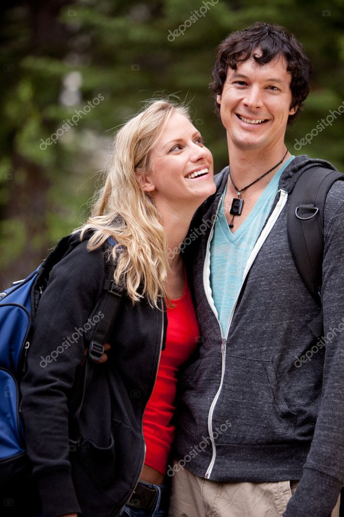 A man and woman outdoors on a hike in a forest — Stock Photo #5710567