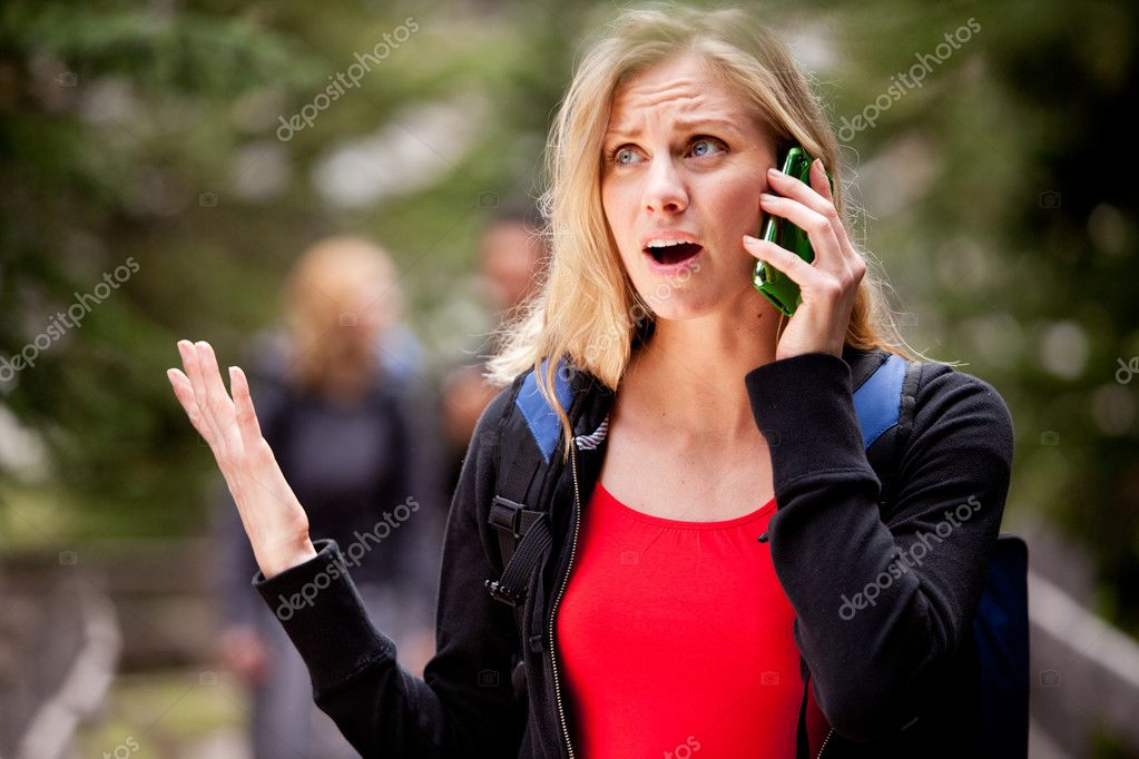 A woman talking on the phone, frustrated with the person she is talking to — Stock Photo #5710632