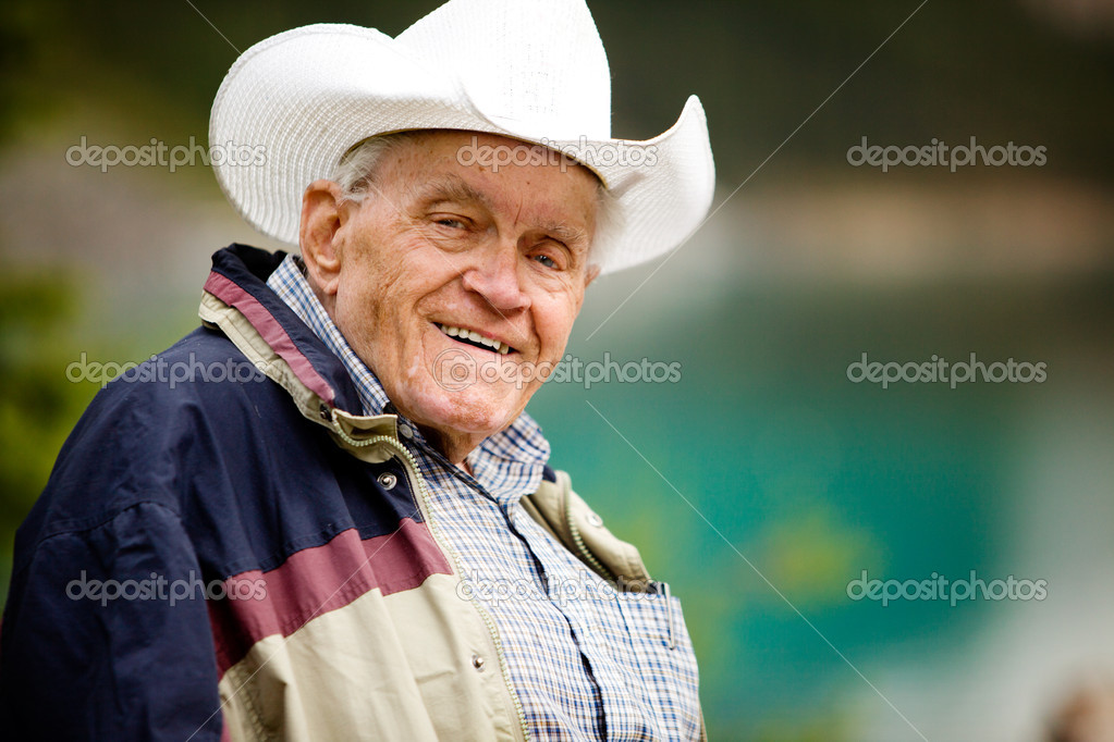 A portrait of a happy elderly man with cowboy hat — Stock Photo #5711037