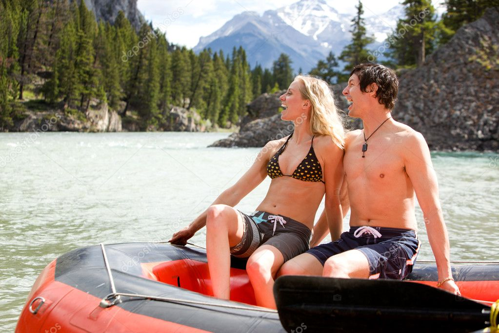 A man and woman rafting on a river — Stock Photo #5711199