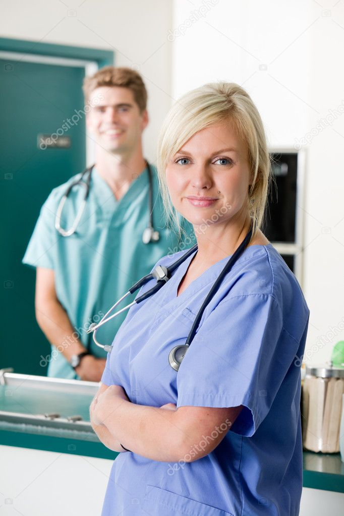 A portrait of a vet and assistant in a small animal clinic — Stock Photo #5711524