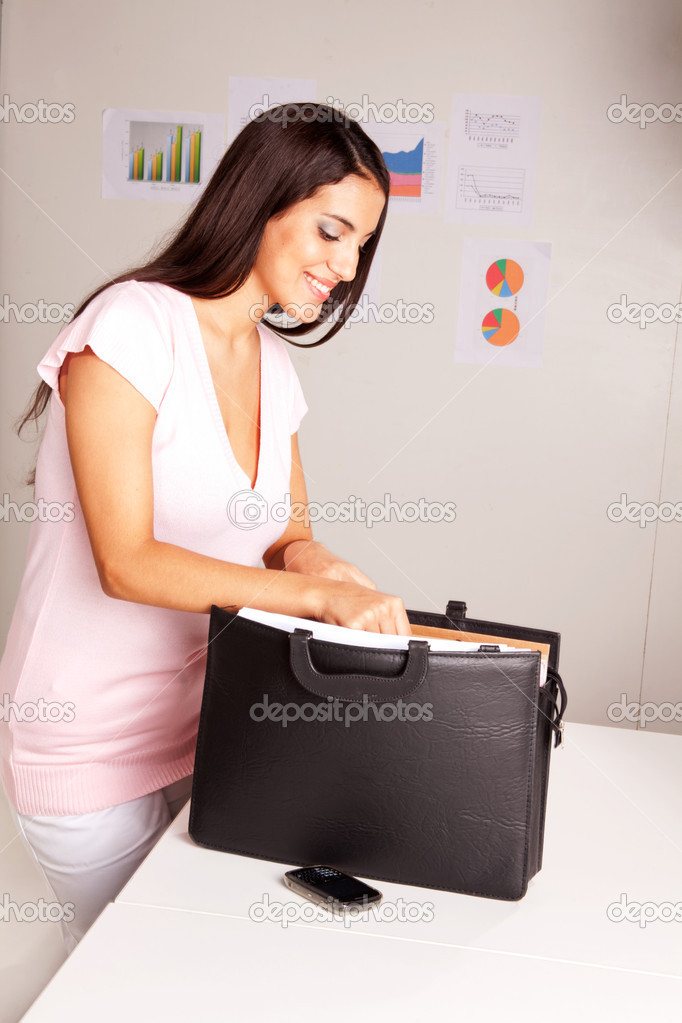 A happy smiling business woman presents some documents — Stock Photo #5713277