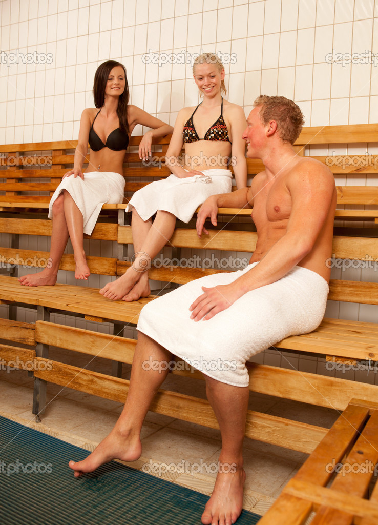Friends in a Sauna laughing and talking together — Stock Photo #5719574