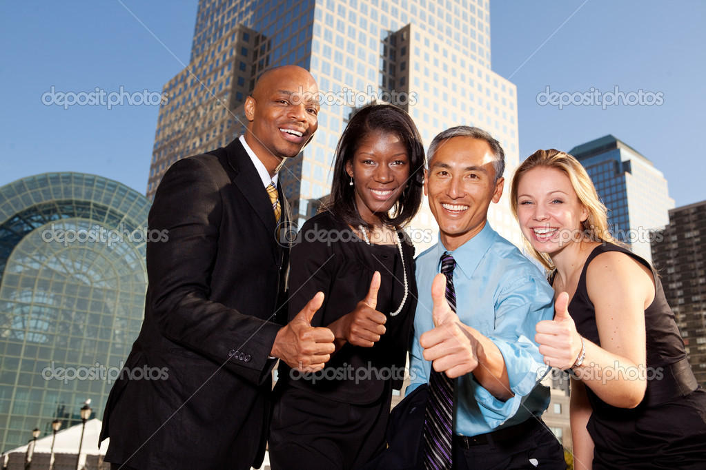 Four business giving thumbs up. Horizontally framed shot. — Stock Photo #5720671