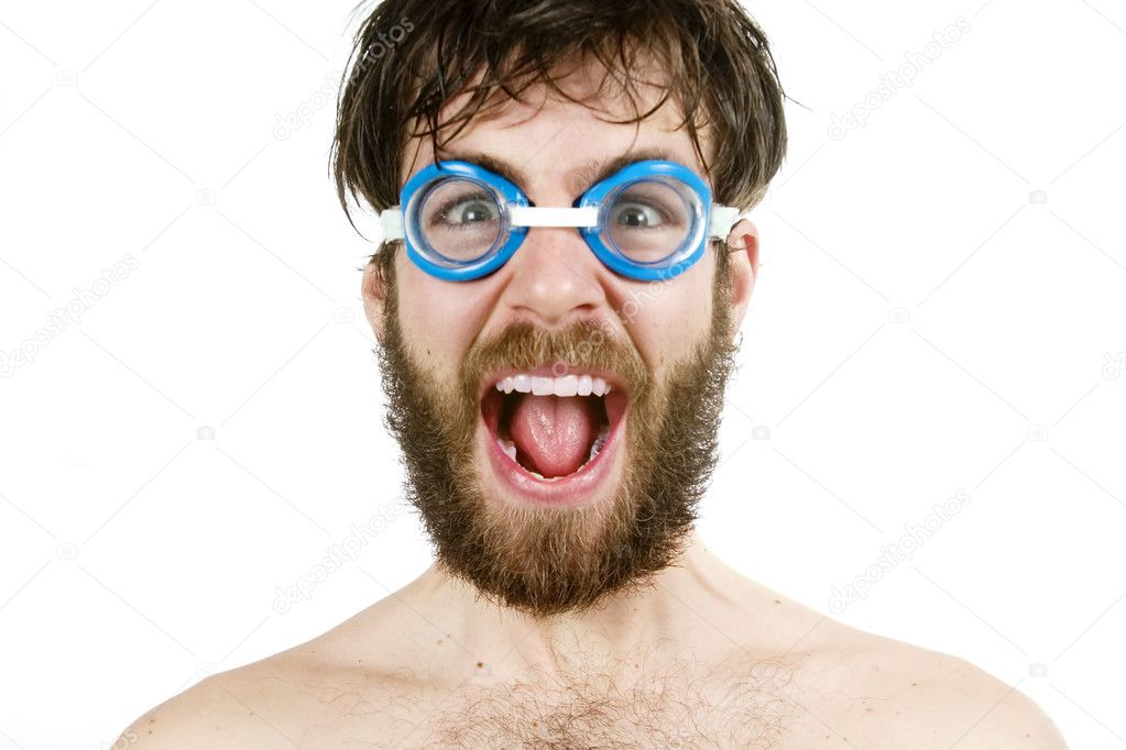 A humorous image of a young bearded male wearing swimming goggles, yelling. — Photo #5723358