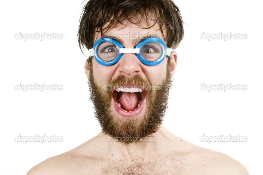 A humorous image of a young bearded male wearing swimming goggles, yelling. — Foto Stock #5723358
