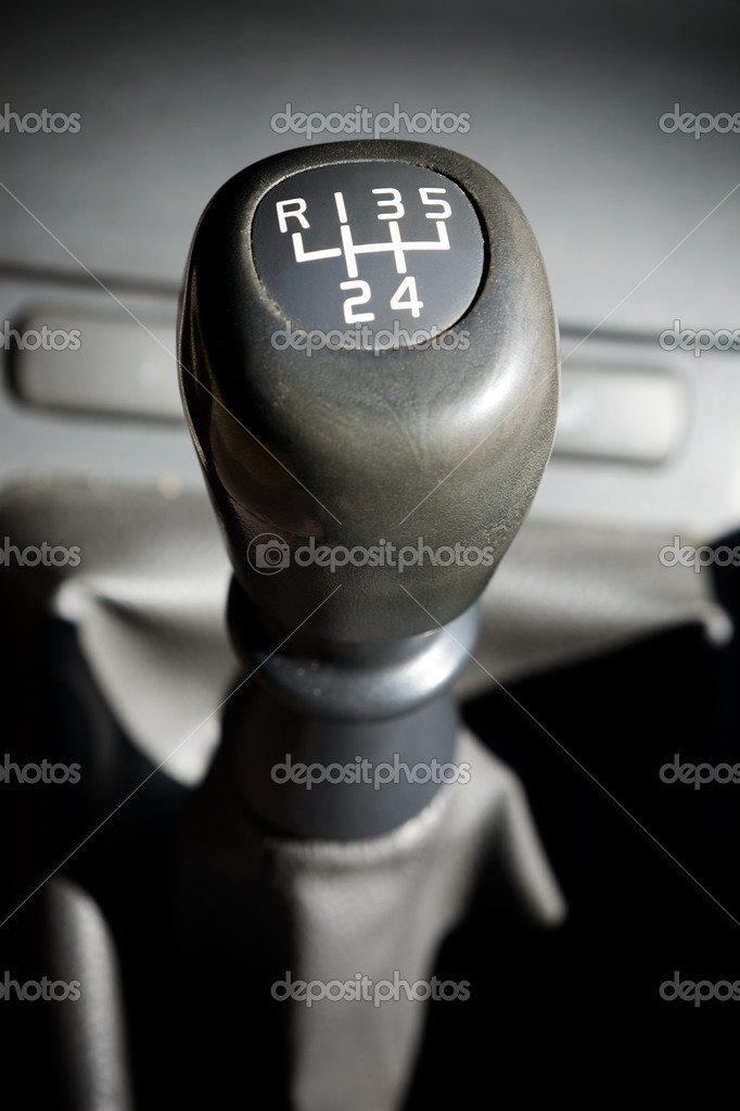A gear shifter with 5 speeds in an older car  Stock Photo #5726648