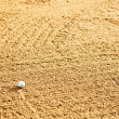 Golf Ball in Bunker - Stock Photo