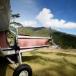 Airplane on Mountain Runway — Stock Photo