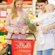 Two Friends Buying Groceries with Baby - Photo