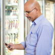 Cell Phone Grocery List — Stock Photo