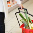Woman pulling Shopping Basket in Grocery Store — Stock Photo