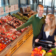 Couple Buying Fruits and Vegetables - Stock Photo