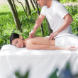 Beautiful woman getting massage from a therapist - Stock Photo