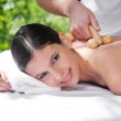 Young woman getting massage by a therapist — Stock Photo #5733854