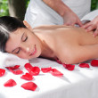 Young woman getting a back massage — Stock Photo #5734311