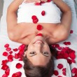 Smiling beautiful woman lying on a massage table — Stock Photo #5734368