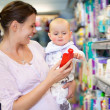 Mother Shopping with Baby in Supermarket — Stock Photo