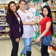 Mother with Child and Friends in Supermarket — Stock Photo