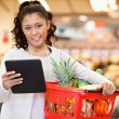 Woman with Tablet PC Shopping List — Stock Photo