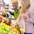 Happy young woman buying fruits — Stock Photo #5734715