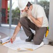 Construction worker working on blueprint — Stock Photo