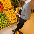 Stock Photo: Buying Lemons