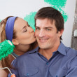 Woman kissing her boyfriend on the cheek — Stock Photo