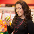 Woman Buying Fruit — Stock Photo #5735211